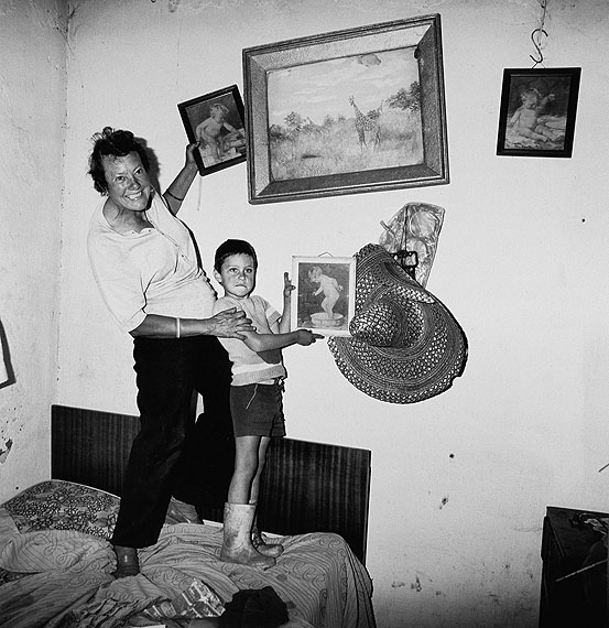 Roger Ballen, Diamond Digger and Son Standing on Bed, Western Transvaal, 1987