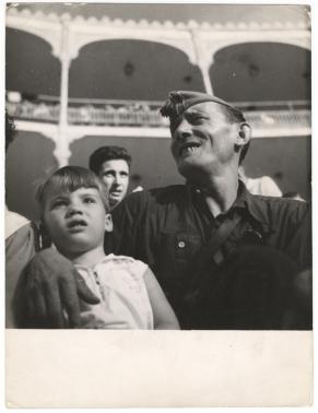 Gerda Taro, Republican Militiaman and Child at Bullfight and Military Show, Barcelona